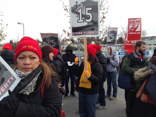 Fast food workers and minimum wage advocates marched from SeaTac to Seattle as part of a national demonstration for a $15 minimum wage on December 5, 2013.