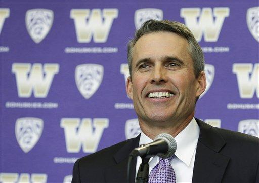 Chris Petersen smiles as he takes questions from reporters after being introduced as the new head football coach at the University of Washington, Monday, Dec. 9, 2013, in Seattle.