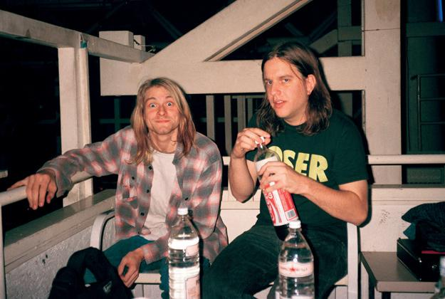Kurt Cobain and Sub Pop cofounder Jon Poneman in conference after the Rome concert. Nirvana's future was in jeopardy, but, by morning, the band had decided to stay together.