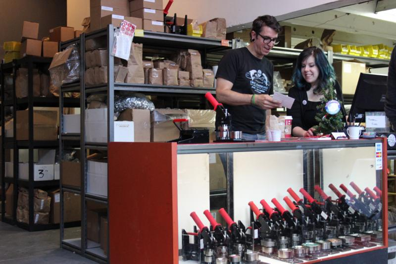 Proprietor Rex Ray chats with Katie, his employee, inside the ButtonMakers shop.