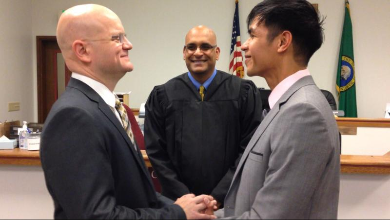 Otts Bolisay and Ken Thompson getting married at the courthouse in Redmond, Wash. When the Supreme Court struck down the Defense of Marriage Act last summer, Thompson could sponsor Otts for a green card.