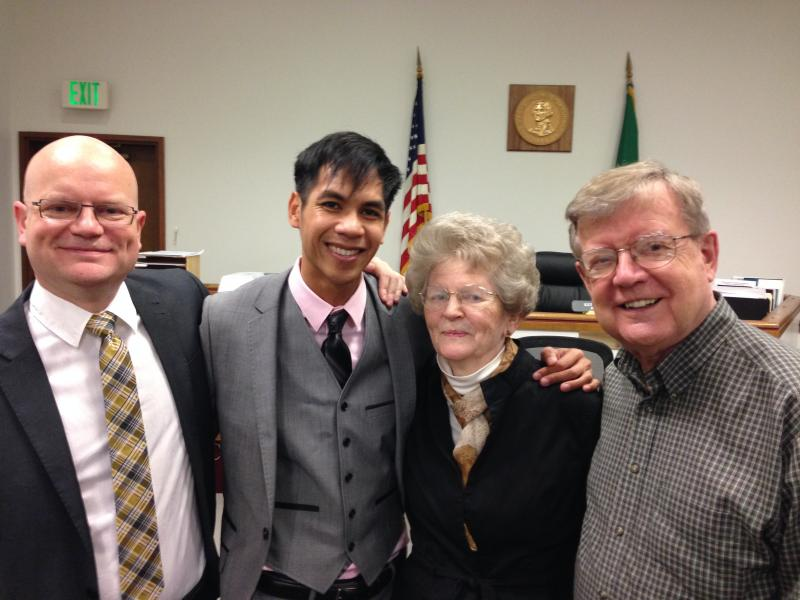 Otts Bolisay and Ken Thompson pose with Thompson's parents at the courthouse in Redmond, Wash.