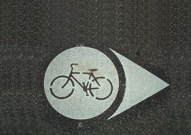 BIKE DOTS are pavement markings for signed bicycle routes. Unlike sharrows, bicycle dots are not intended to provide guidance on bicycle positioning but are a tool to provide wayfinding.