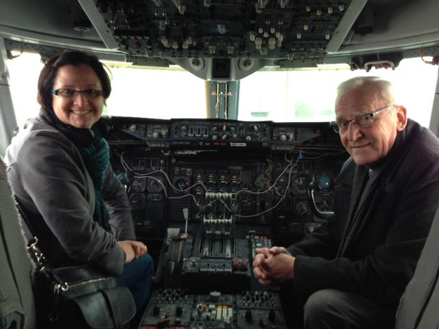 Carolyn Adolph and Barry Latter, docent at the Museum of Flight and former Boeing engineer with the 747 program, pose in a model of the original 747.