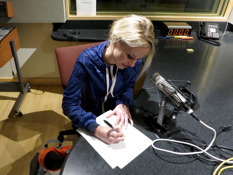 Allie Brosh sketching the KUOW staff a souvenir in studio.