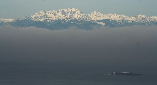 A Washington state ferry moves through the fog.