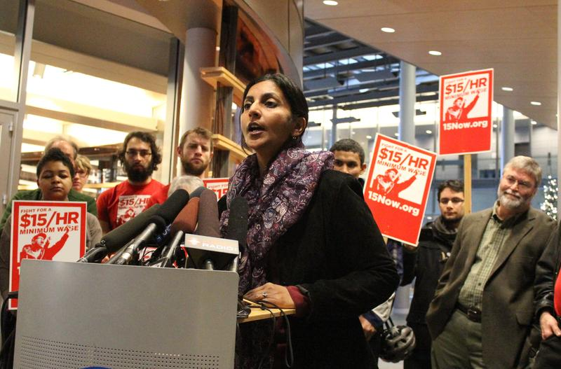 Newly-elected Socialist City Councilmember Kshama Sawant speaks at a city hall press conference on the $15 an hour minimum wage.