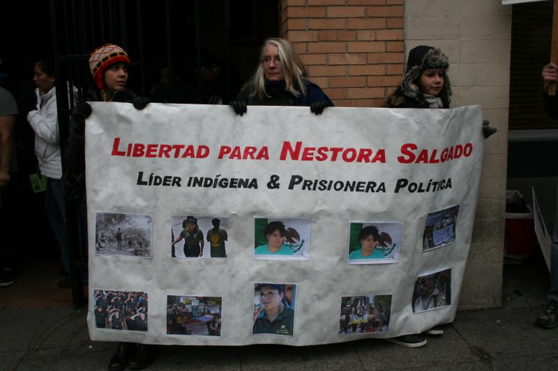 Supporters hold signs demanding Nestora Salgado's release.