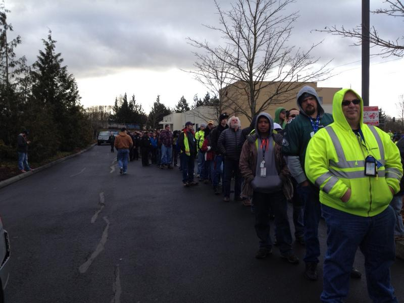 Boeing machinists line up in Everett to vote on a contract offer Friday.