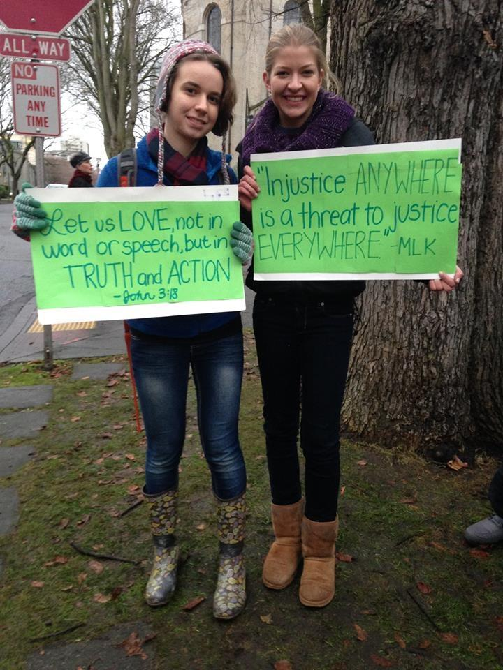 Holy Names students Audrey Long and Theresa Edwards at a December rally outside the Archdiocese of Seattle in support of former Eastside Catholic vice principal Mark Zmuda.