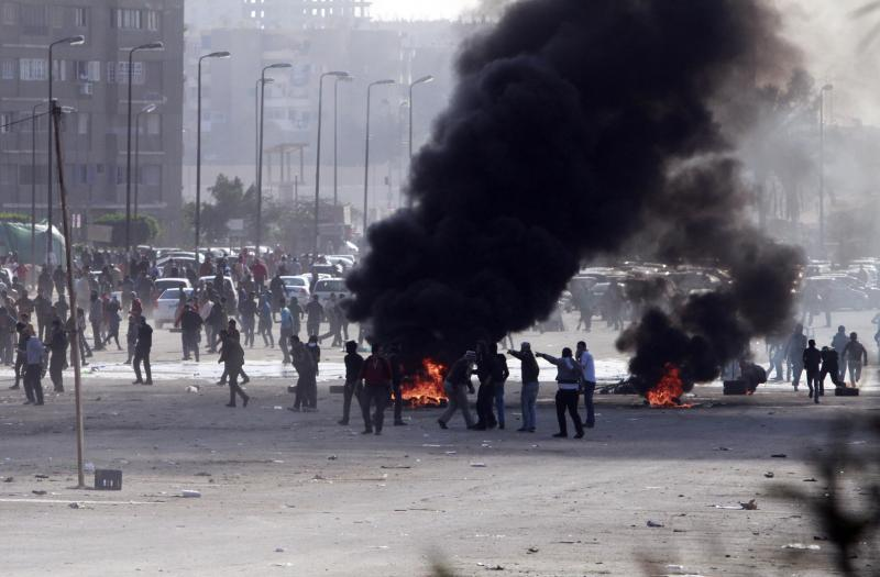 Supporters of ousted President Mohammed Morsi damage an area on a street as they protest against the government in Cairo's Nasr City district on Friday.