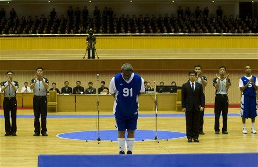 Dennis Rodman bows to North Korean leader Kim Jong Un, seated above in the stands, before an exhibition basketball game with US and North Korean players at a stadium in Pyongyang, North Korea, on Wednesday.