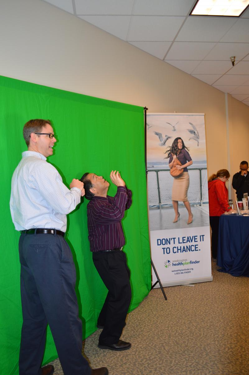 "Participants take a picture in front of a green screen to get their image into a ""Don't Leave it to Chance"" promotion through Wahealthplanfinder."