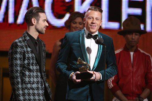 Ryan Lewis, left, and Macklemore accept the award for best new artist at the 2014 Grammy Awards.