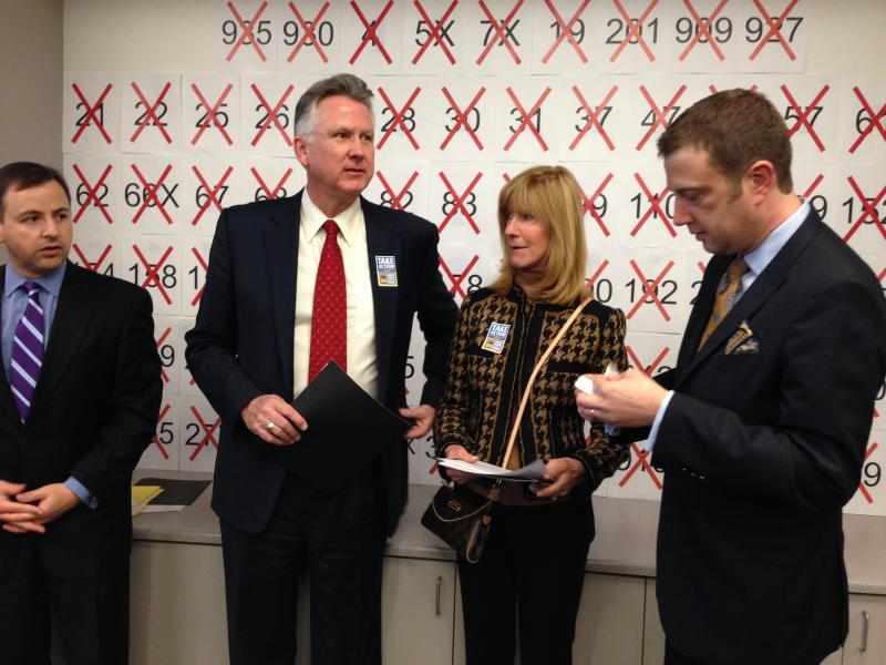 From left, King County Councilmembers Rod Dembowski, Larry Phillips, Jane Hague and Joe McDermott prepare for a press conference. The poster behind them lists targeted bus routes.