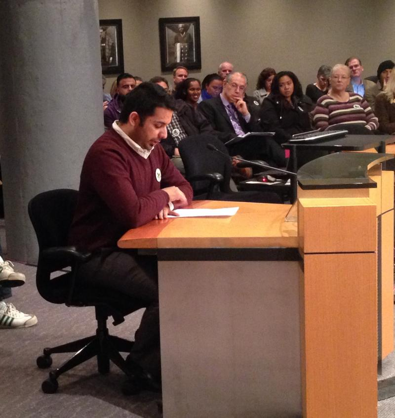Mohammad Kadhim, a baggage handler at Sea-Tac Airport, appeals to Port of Seattle Commissioners for higher wages.