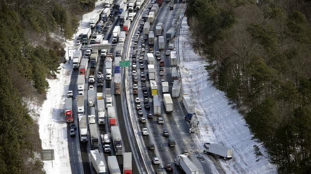 "Traffic is snarled along the I-285 perimeter north of Atlanta's metro area Wednesday. Georgia Gov. Nathan Deal has called Tuesday's snow storm ""unexpected"" — prompting a response from weather forecasters."