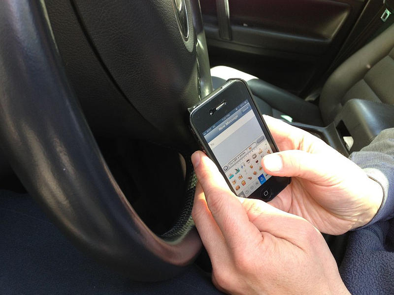 Having a phone in your hand while driving could cost you $136 under the new law.