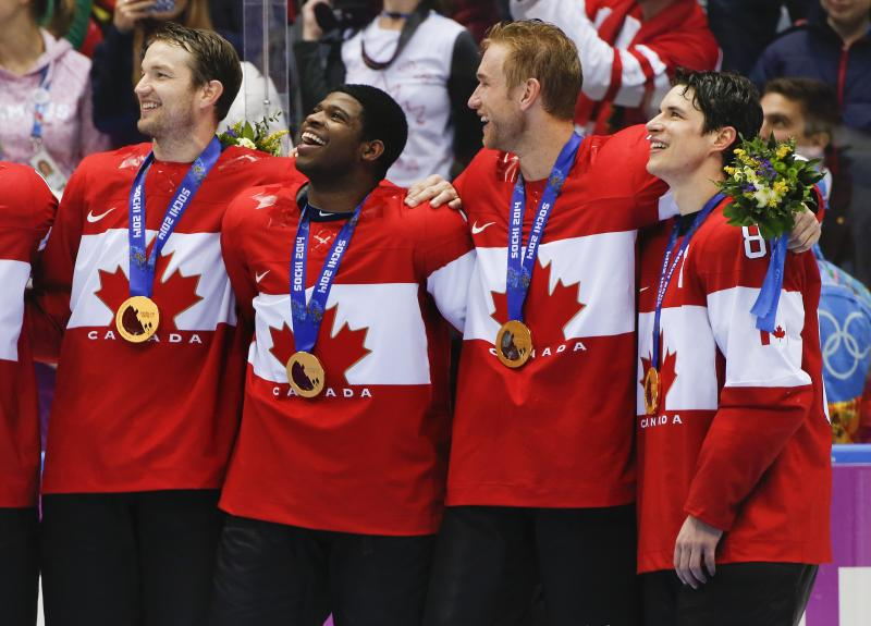 Canada forward Sidney Crosby, far right, stands with teammates for the Canadian national anthem after beating Sweden 3-0 in the men's gold medal ice hockey game at the 2014 Winter Olympics, Sunday, Feb. 23, 2014, in Sochi, Russia.