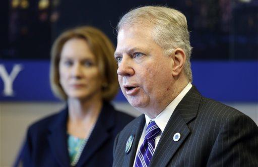 Western Washington U.S. Attorney Jenny Durkan, left, looks on as Seattle Mayor Ed Murray addresses a news conference on police reforms in Seattle, Feb. 4, 2014