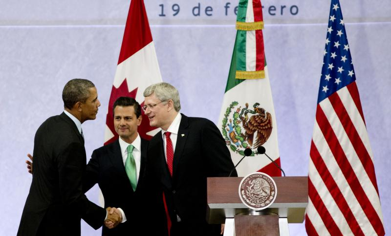 President Barack Obama, left, Mexico's President Enrique Pena Nieto, center, and the Prime Minister of Canada, Stephen Harper, shake hands at the end of a news conference concluding the North American Leaders Summit in Toluca, Mexico.