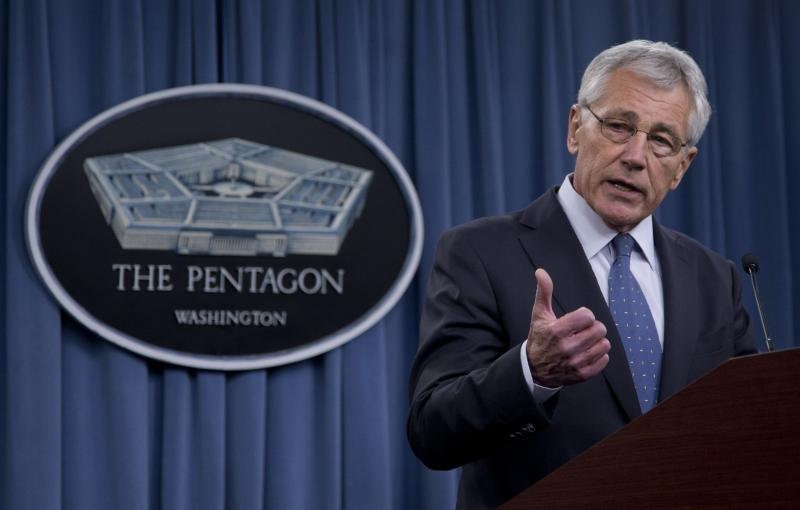 Defense Secretary Chuck Hagel briefs reporters at the Pentagon, Monday, Feb. 24, 2014, where he recommended shrinking the Army to its smallest size since the buildup to U.S. involvement in World War II in an effort to balance postwar defense needs with bu