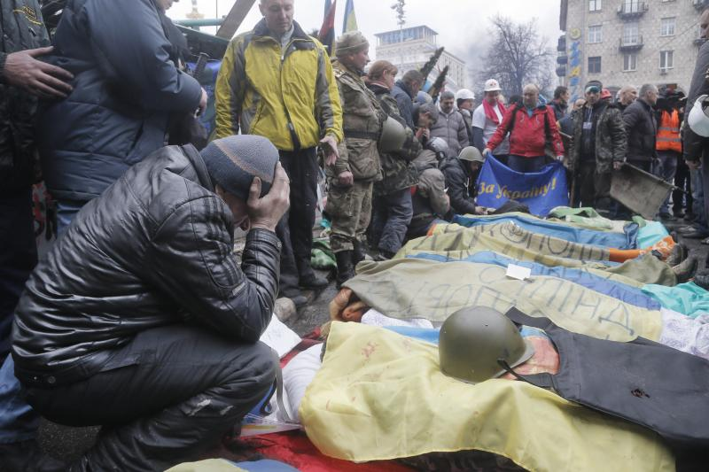 Activists pay respects to protesters killed in clashes with police, during clashes with riot police in Kiev's Independence Square, the epicenter of the country's current unrest.