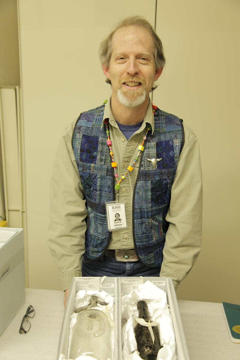 Burke Museum educator and author David Williams with artifacts found from early Seattle.