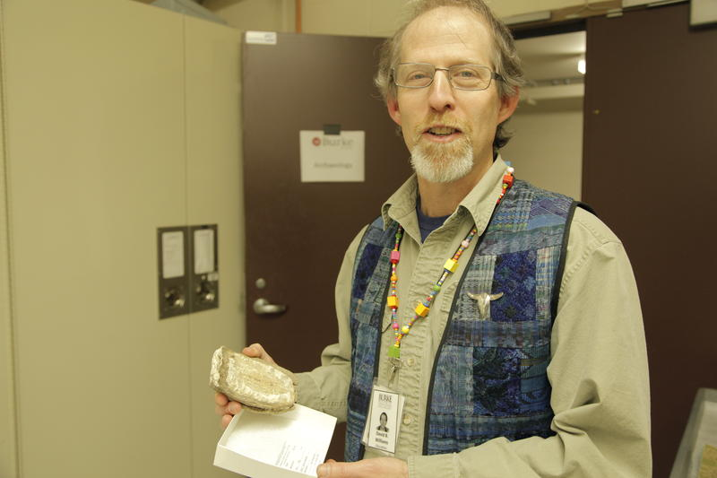David Williams holds a mammoth tooth collected during the Denny Regrade.