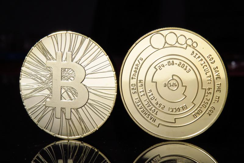 Not a real bitcoin: the currency doesn't have a physical form; pictures like this are novelty items that often have bitcoin information on them.