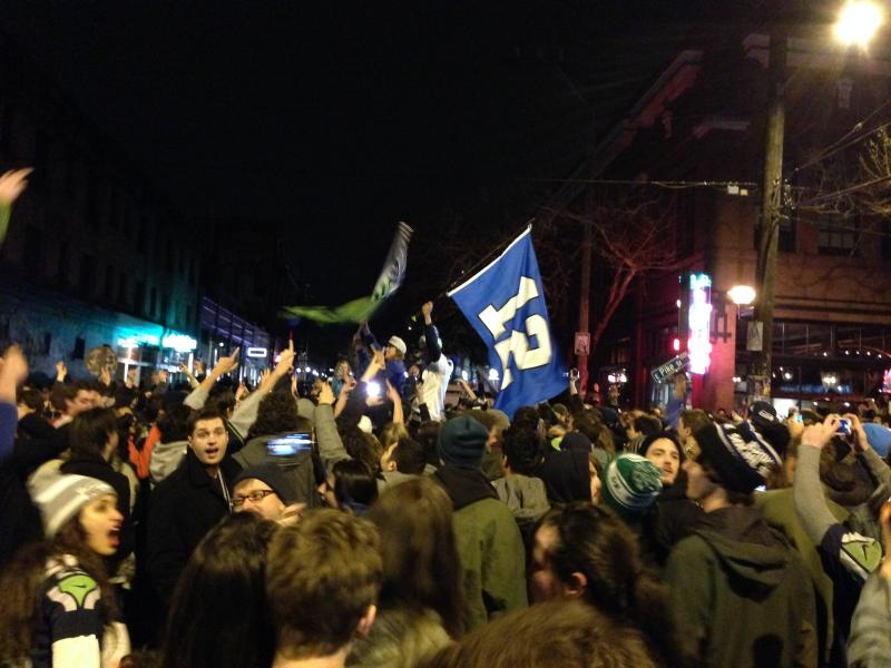 Fans celebrated in Capitol Hill after the Seahawks' Super Bowl victory on Sunday.
