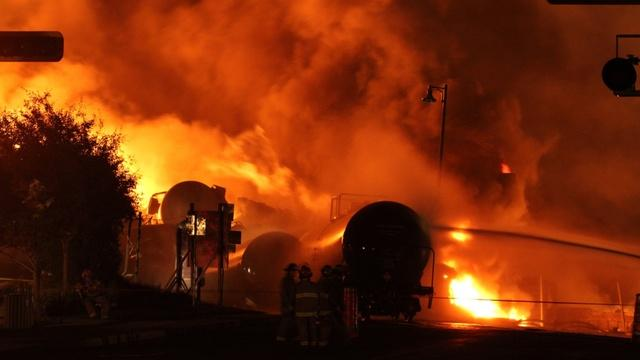 United States safety regulators have adopted an emergency order requiring tests of crude oil before shipment by rail. The move is in response to a string of explosions and fires, like this one in Quebec, which claimed 47 lives.