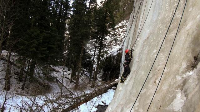 Freshman Aleyna Porreca climbs the Weeping Wall outside Dayton, Wash. Whitman College's Outdoor Program brings students to climb the wall when it is frozen in the winter.hington's Blue Mountains, behind