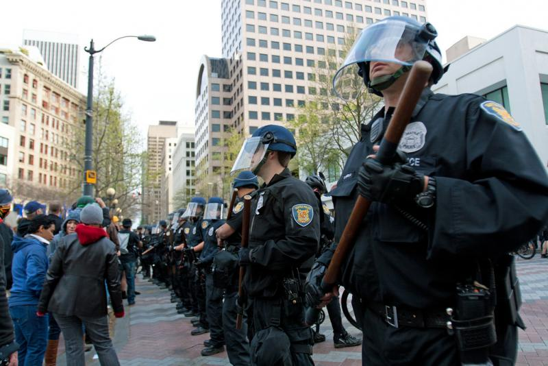 Seattle Police form a barricade on May 1, 2012. As a result of the May Day protests, a federal courthouse was vandalized. Two people who were not present at the protests were found in contempt of court for not testifying about the events.