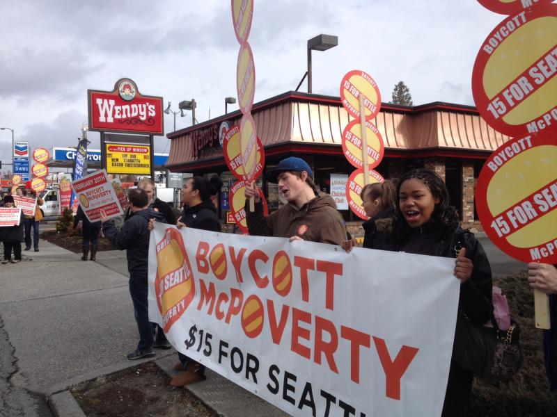 McPoverty protesters outside Wendy's restaurant on Lake City Way in Seattle on Thursday, Feb. 20.