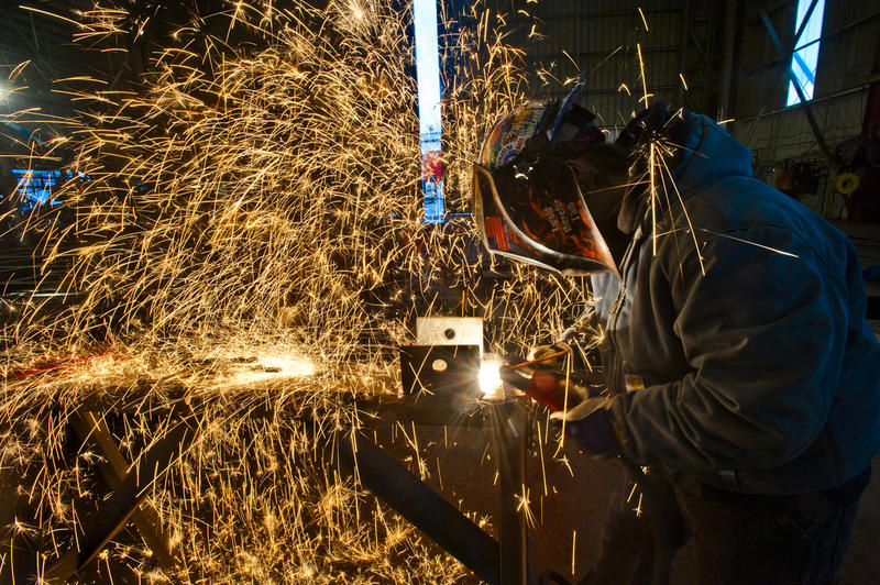A welder at Vigor Industrial works on a new ferry for the Washington State Ferry System.