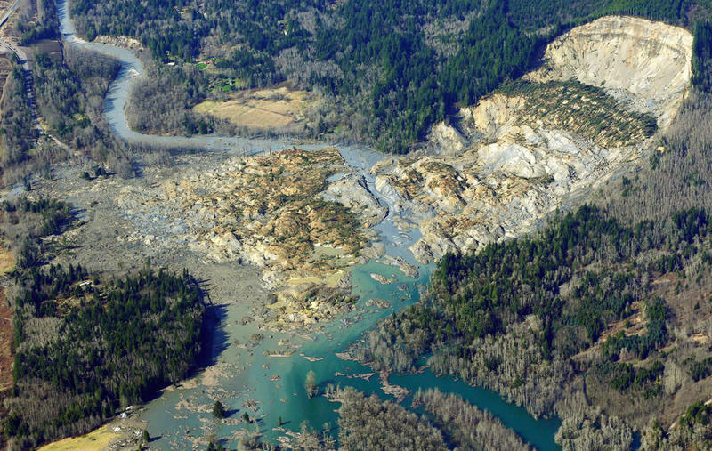 The massive mudslide that killed at least eight people and left dozens missing is shown in this aerial photo, Monday, March 24, 2014, near Arlington, Wash.