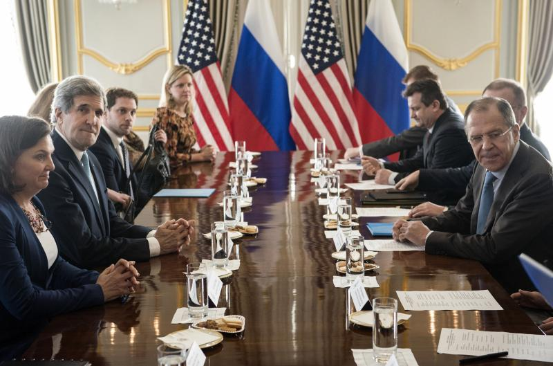 U.S. Secretary of State John Kerry, second left, and Russian Foreign Minister Sergey Lavrov, right, wait to start their meeting at Winfield House, the residence of the U.S. ambassador, in London, Friday March 14, 2014.