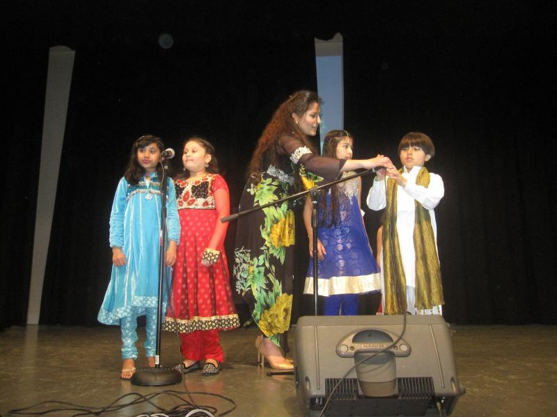 Kiran Shereyar prepares children for their song on Pakistan Day in Redmond