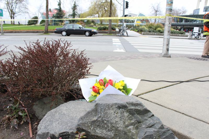 Bouquet of flowers rests across the street from the helicopter crash site on Tuesday.