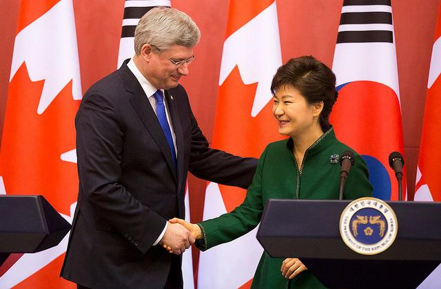 Canadian Prime Minister Stephen Harper and South Korean President Park Geun-hye reach a historic free trade agreement.
