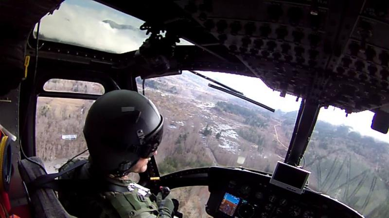 Helicopter Pilot Ed Hrivnak helps search the debris field. He shared this photo on March 26, 2014, on his Facebook profile.