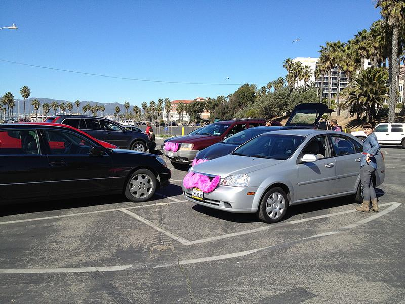 Cars for the ridesharing company, Lyft, can be identified by the pink mustaches placed on the front bumper.