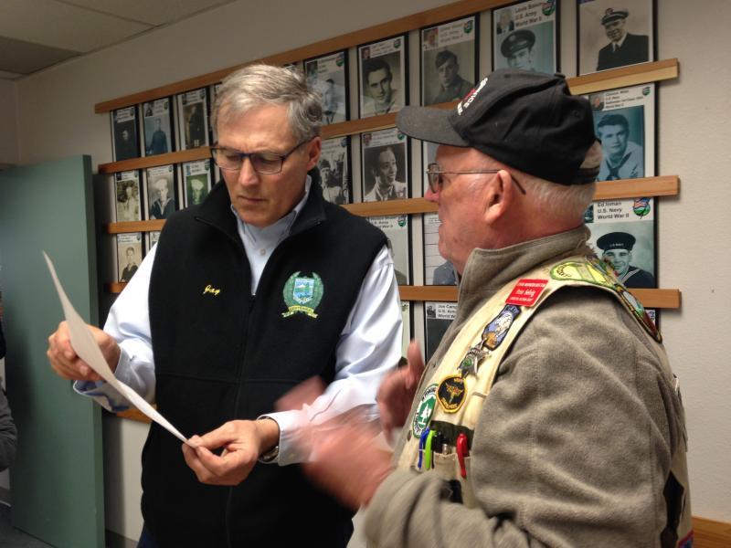 Governor Jay Inslee talks with Darrington resident Pete Selvig at Darrington's City Hall Monday evening.