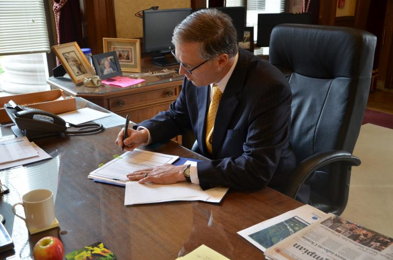 Governor Jay Inslee signs the  request for a Major Disaster Declaration for the Oso mudslide.
