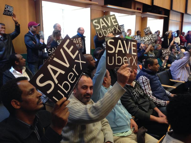 Drivers and supporters of app-based rideshare service UberX pack Seattle City Council chambers.