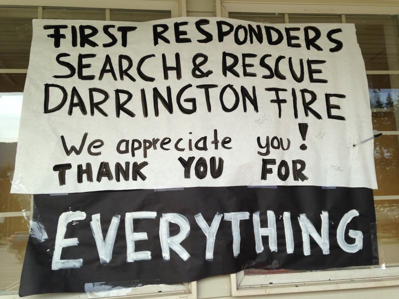 Hand-lettered sign outside Darrington's grocery store thanks rescue workers.