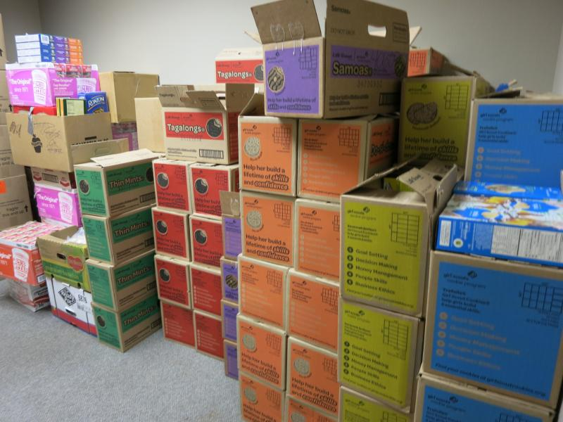 Girl Scout cookies take up half a room at an Arlington office park.