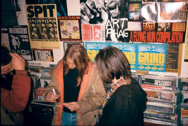 Kurt Cobain signs one of his first autographs, Rough Trade Records, London, in December 1989.