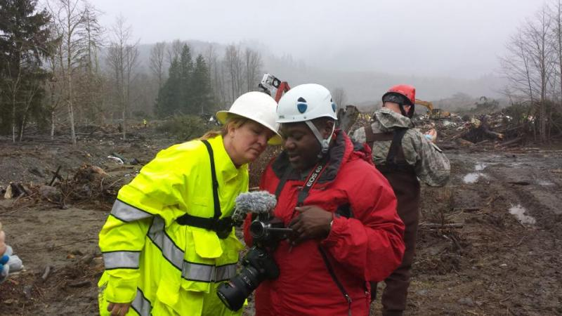 Volunteer Merry Killinger learns from Stacy Noland how to document rescue and recovery efforts in Oso, Wash.